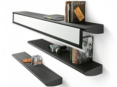 bookshelf system with integrated projection screen. By http://www.livit.it/