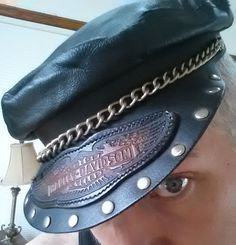Just an awesome vintage genuine Harley Davidson Leather Biker's Cap. Late 70's early 80's. Great look with the silver colored rivets along the brim, thick metal chain, the brown Harley Davidson branded logo across the front and the uber soft black leather. It has the elastic/stretch material in the back so it stretches to fit. I'd say size large/ x-large as it fits my head comfortably. A great addition to any vintage motorcycle collection!