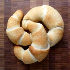 BUNS - 4 cups (1 pound, 2 ounces) all purpose flour  2 teaspoons instant yeast  2 tablespoons cane sugar  1 1/2 cups cool water   1 1/2 teaspoons salt  4 tablespoons butter, softened  Olive oil for drizzling   Dried herbs (optional)  Melted butter (optional)