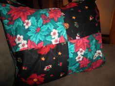 Scrap Christmas fabrics made into a Christmas pillow cushion.