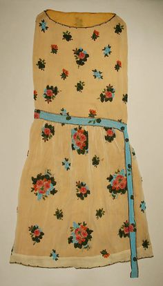 Dress, 1920s - The Metropolitan Museum of Art. The entire floral design is beaded! The belt is trompe l'oeil, also beads.