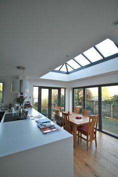 Upgrade your kitchen by adding a glass extension. It'll bring in lots of light a... - http://centophobe.com/upgrade-your-kitchen-by-adding-a-glass-extension-itll-bring-in-lots-of-light-a/