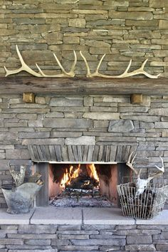 A fireplace doesn't have to stand out to have an impact. The modern fireplace in this neutral living room by Elms Interior Design Mosaic Tile Fireplace, Slate Fireplace, Modern Fireplace, Fireplace Design, Fireplace Mantels, Fireplace Ideas, Fireplaces, Elk Horns, Elk Antlers