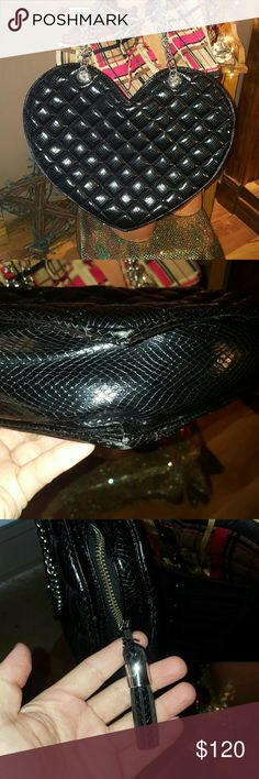 Bebe quilted large heart bag black Flawless Bebe quilted large heart bag in Flawless condition, carried once and my husband hated it so it's just been hanging on my chair, very spacious, very unique, I have sold my collection of the heart shaped bags this is my last one that I have. Zipper tassel and zipper works perfect, no scuffs or scratches and it's very shiny.  I mainly list Bebe items so please check out my other listings and I sell on other sites so this may not be here long.  I now…