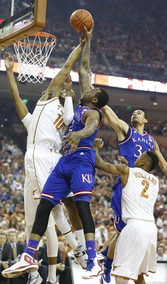 Kansas forward Cliff Alexander (2) fights for a rebound with Texas forward Jonathan Holmes (10) during the first half, Saturday, Jan. 24, 2015 at Frank Erwin Center in Austin, Texas.