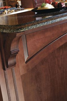 An olde world cabinet bracket with fine furniture details like this one will add a unique aura to any space.