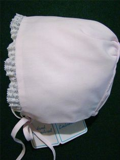 The exquisite batiste baby bonnet has delicate French lace trim around the face, is elasticized in back and ties under the chin. (nwt's) Perfect to go with most of my Feltman Brothers apparel and my hand embroidered girls dresses, topper sets, daygowns and bubbles. Perfect for your baby girl or reborn baby doll.