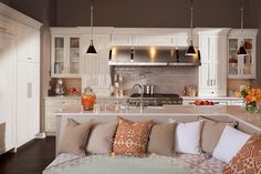 White on white transitional kitchen design with an L-shaped kitchen island in Latte.