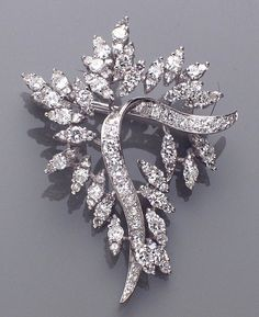 A diamond and platinum brooch, circa 1950's  the spray brooch set throughout with round brilliant and single-cut diamonds; estimated total diamond weight: 4.50 carats.