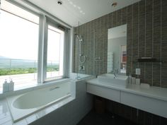 Even bathroom comes with a view at Youtei Tracks Penthouse. htholidays.com/niseko-accommodation/luxury/youteitracks