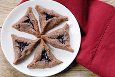 Gluten Free Hamantaschen for Purim with a twist, these fun little Jewish desserts are made with raspberry jam and dark chocolate.