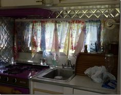 curtain made of hankies in vintage camper