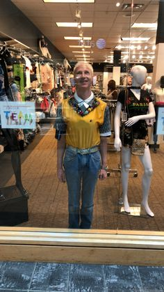 Christopher elf Christmas elf modeling inside a storefront window at Arbor Place Mall Douglasville Georgia  Modeling Christmas elf Christopher elf parade kid Douglasville Atlanta Lithia Springs Temple Carrollton Powder Springs Marietta Kennesaw Dallas Rockmart Cedartown Cartersville Acworth