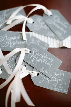 gray escort cards shot by Alea Lovely (could do purple w/ a silver ribbon? or silver w/ purple?)