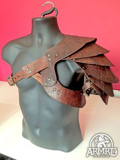 Gladiator Style Shoulder-Shielding - Easily made by cutting leather and riveting pieces together.