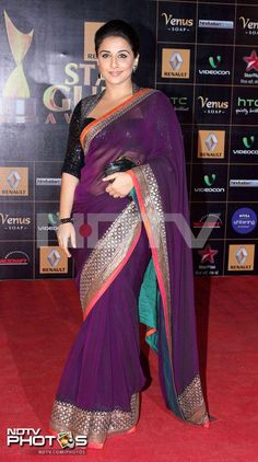 Guild Awards 2013: Vidya Balan maintained her sari style in a purple Sabyasachi, but opted for a more glamourous look than her earlier traditional appearances.
