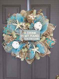A Drink In My Hand, Toes in the Sand Beach Burlap/Deco Mesh Wreath with Sea Shells by BeautifulMesh on Etsy https://www.etsy.com/listing/212398153/a-drink-in-my-hand-toes-in-the-sand