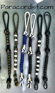 Paracordist Creations LLC - MiBSAR Ranger Pace Counter Beads , $16.95 Keep track of your pace count on those hikes and bushwhacks like the Army Rangers do. Each bead is hand woven from 550 cord. THESE ARE NOT PLASTIC BEADS. They are silent, won't break in cold weather conditions and won't slide on their own! Secure to carabiner or belt using integrated loop. Fixed knots are larger than beads, allowing solid grip for sliding back beads, as well as low light/no light operation by feel.