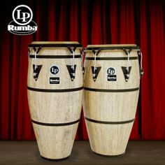 """Latin Percussion LP611-KIT1 Rumba 11 and 12 Conga Set. Traditional Design with Steel Bands by Latin Percussion. $202.67. LP Rumba Series offers LP's very best in craftsmanship. Each drum has a Classic retro design with unique exterior bands that harken back to the days of the famous Palladium Dance Hall. Rumba features 28"""" Tall Siam Oak Wood Shells, Traditional Rims, Side handles for easy transporting and Hand Selected Natural Rawhide Heads. There is no other drum like it!..."""