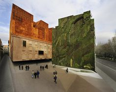 CaixaForum, Paseo del Prado, Madrid, Spain. By Herzog and de Meuron. Sociocultural centre, rehabilitated former electric power station, completed 2008. With a distinctive vertical garden next to it.