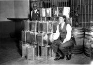 Prohibition bust in Glendale, 1928. Bootlegger paraphernalia stored in the Glendale Police Department jail after a raid, March 22, 1928. The bust occurred at the Comalt Co., Inc., a beverage producer in Glendale. San Fernando Valley History Digital Library.