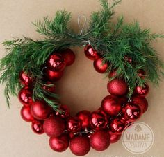 This Christmas Bauble Wreath made with Christmas Balls on a coat hanger is so simple to make and looks fantastic!
