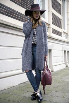 Jeans, plaid skirt, grey coat, hat.
