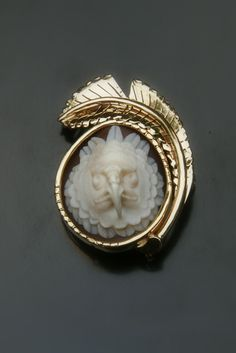Harpy Eagle cameo brooch, set in 18kt yellow gold by Rainforest Design®  The Harpy Eagle is the national bird of Panama, and is a protected species.