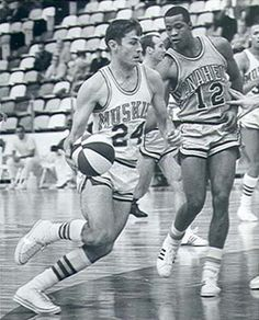 Ervin Inniger of the Minnesota Muskies drives on Lester Selvage of the Anaheim Amigos in front of the usual throng that attended Muskies' games during the inaugural season: Pro Basketball, Basketball Leagues, Basketball Photography, Sports Team Logos, Basketball Association, School Sports, Amazing Pics, Aba, Major League