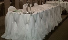 """Glamour Head Table Decor-Beautiful sheer draping with """"pick ups"""" held by large sterling silver and rhinestone accents! Wedding"""