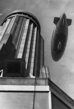 "The airship Columbia over the Empire State Building, 1931, photo by the New York Journal American. The dirigible did not, in fact, ""la..."