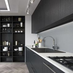Find space in places you never thought of. Take these floor-to-ceiling shelves, they save counter space and make for a beautiful display. Black Kitchen Cabinets, Black Kitchens, Cool Kitchens, Upper Cabinets, Drop In Kitchen Sink, New Kitchen, Kitchen Decor, Awesome Kitchen, Simple Kitchen Design