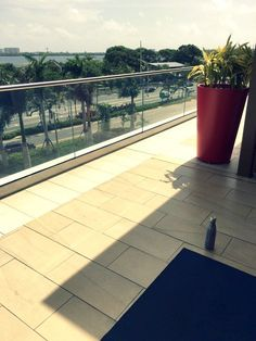 The water bottle and yoga mat that never let you down.  Yoga on the terrace at Mall of San Juan Lululemon.