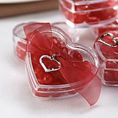 Valentines day heart shaped wedding favors. Aren't they cute? Fill them with red hots.