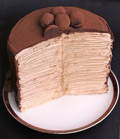 Crepes Cake with swiss meringue buttercream and chocolate truffles. OMG I'm a fan of crepes cakes.my fav is grandmarnier crepe cake but will have to try this one. Chocolate Crepes, Chocolate Truffles, Cupcakes, Cupcake Cakes, Dessert Crepes, Crepe Cake, Coffee Blog, Food Cakes, Pancake