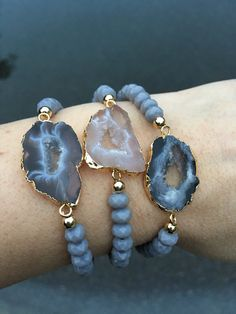 Stretchy bracelets choose from numbered photo. Agate Druzy sliced with gold electroplated edge and grey glass beads. Fits small to medium. Will come in gift box