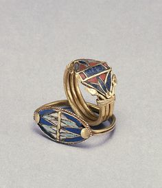 Two Rings with Lotus Flowers, 1400-1200 BC (New Kingdom) - gold with glass, lapis lazuli, and carnelian inlay