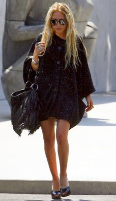 One of the Olsen twins (I can't tell them apart anymore) love this; awesome coat/top w/ a fringed bag & heels