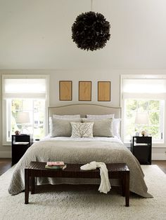 """♥  ♥Calming Decor  This bedroom is a mix of neutral colors and natural materials. A mix of textures -- linen-upholstered headboard, soft velvet coverlet and pillow, thick wool rug, and woven leather bench -- keeps the subtle shades interesting. """"Soft gray walls almost shimmer with creams and whites,""""♥  ♥"""