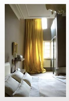 A rich yellow enlightens the neutral colors of the room.