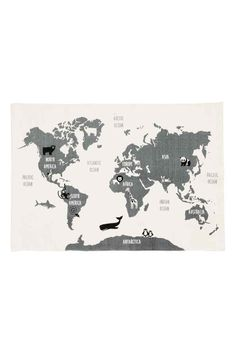 World map-motif cotton rug: Rectangular cotton rug with a world map print on the top and anti-slip protectors on the bottom.