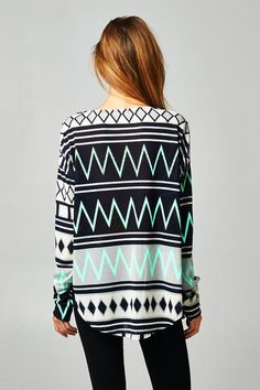 This fun zig zag tunic is perfect for leggings are skinny jeans! The colors are fun and a pop of color with the jade and black!%0D%0A%0D%0A%0D%0A1st Cut Estimated Arrival Date is 10/17/14 to me.%0D%0A%0D%0AMulti Print Tunic Top%0D%0A%0D%0A%0D%0A%0D%0A%0D%0A%0D%0AWILL BE SHIPPED BY 10/17