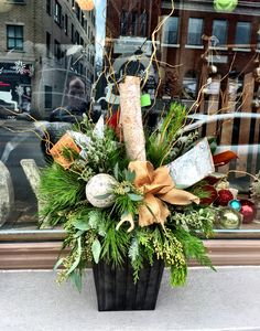Christmas arrangement for indoors or out.  By Caruso & Company