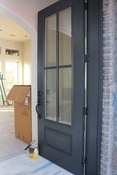 Door painted in Benjamin Moore Wrought Iron. One of the best dark door and trim colors.