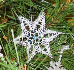 """Bobbin Lace Star made for the Piedmont Lace Guild """"Lacy Christmas Tree"""".  The tree is on display at Molly's Irish Pub in Warrenton, VA.  It will be raffled off to benefit the Virginia Wounded Warrior Program on Dec. 14."""