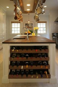 Kitchen island with built-in wine rack, butcher block countertop and prep sink. Rustic pot rack hanging over kitchen island with copper pots and pans. This without the wine rack! Wine Storage, Kitchen Storage, Kitchen Decor, Storage Drawers, Storage Ideas, Kitchen Ideas, Storage Rack, Rustic Kitchen, Design Kitchen