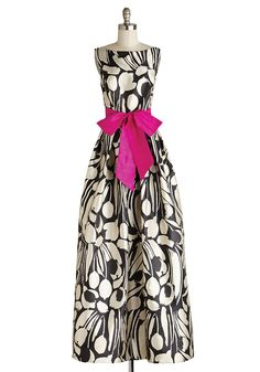 A gown worthy of a gala, the Earned Adulation Dress features a graphic black and ivory floral with fuchsia sash. Fully lined, princess seaming, pleated skirt and side pockets. $260.00. modcloth.com