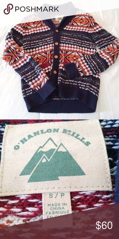 Urban outfitters knit cardigan Pre-owned. In excellent condition. Cozy navy and multicolored cardigan with brown wooden buttons. This is a men's size small. Brand is O'Hanlon Mills from urban outfitters. Urban Outfitters Sweaters Cardigans
