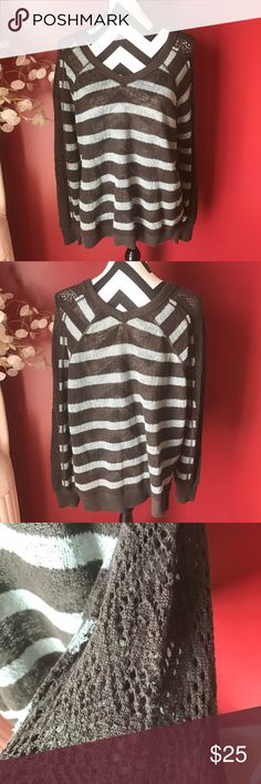 Free People sweater Worn once in great shape no flaws it has lace detail on the sleeves. Colors are brown and blue Free People Sweaters V-Necks