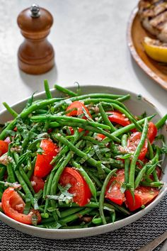 NYT Cooking: This simple summer salad pairs beautifully with practically any grilled meat or fish, and it's quite easy to make. Just blanch the green beans until crisp tender, then toss with wedges of ripe tomato and a bright vinaigrette of Dijon mustard, red wine vinegar, garlic, shallots and olive oil. A shower of chopped fresh basil across the top finishes it off.